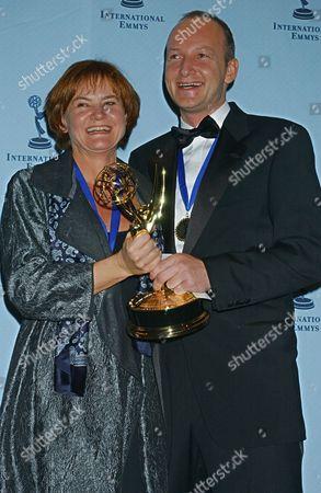 "BERNTH SVEISTRUP Director Piv Bernth, left, and writer Soren Sveistrup, both of Denmark accept the award for best drama series ""Nikolaj and Julie"" at the 31st Annual International Emmy Awards in New York"