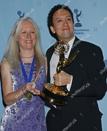 "WHITE PEAKE Jacqueline White and Peter Peake, of BBC Bristol/Comic Relief Co-Production, hold the Children and Young People award for the show ""Legend of the Lost Tribe"" at the 31st Annual International Emmy Awards in New York"