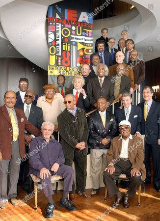 """National Endowment for the Arts Jazz Masters gather for a group photo, reminiscent of Art Kane's 1958 """"A Great Day in Harlem,"""" in New York . Included in the photo are George Russell, Dave Brubeck, Nat Hentoff, Louie Bellson, David Baker, Percy Heath, Billy Taylor, Chico Hamilton, Jim Hall, James Moody, Randy Weston, Ron Carter, Jackie McLean, Gerald Wilson, Jimmy Heath, Hank Jones, Horace Silver, Anita O'Day, Benny Golson, Frank Foster, Cecil Taylor, Roy Haynes, Clark Terry, and NEA Chairman Dana Gioia, standing at right"""