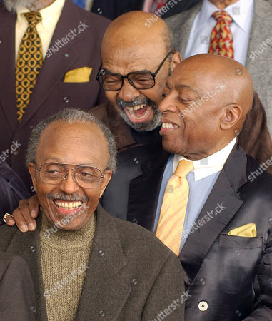 Three National Endowment for the Arts' Jazz Masters, Jimmy Heath, left, James Moody and Roy Haynes, right, converse as they gather with other jazz greats for a photo in New York . The NEA Jazz Masters program confers the nation's highest honor for the uniquely American art