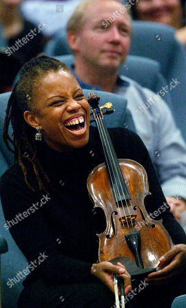 CARTER Jazz violinist Regina Carter laughs while conducting a hands-on master class workshop for students and emerging young professional musicians as part of the Portland Jazz Festival, at Lincoln Recital Hall on the campus of Portland State University in Portland, Ore. Trained as a classical violinist, Carter switched to jazz as a teenager