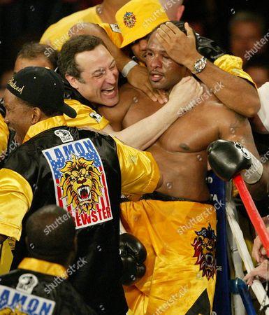 BREWSTER SIMON Lamon Brewster celebrates with promoter Sam Simon, left, after beating Wladimir Klitschko at the Mandalay Bay Resort Hotel & Casino in Las Vegas