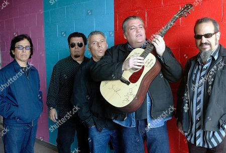 Louie Perez, Cesar Rosas, Conrad Lozano, David Hidalgo, Steve Berlin Members of the band Los Lobos, from left, Louie Perez, Cesar Rosas, Conrad Lozano, David Hidalgo holding a guitar, and Steve Berlin posing for a photograph, in Los Angeles. They are the progenitors of Chicano rock 'n' roll, the first band that had the boldness, and some might say the naiveté, to fuse punk rock with Mexican folk tunes