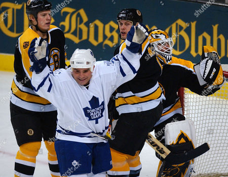 MCGILLIS Toronto Maple Leafs right wing Tie Domi, left, raises his arms after his second-period goal off Boston Bruins goalie Felix Potvin in Boston, . At rear behind Domi are Bruins defenseman Jeff Jillson, left, and defenseman Dan McGillis