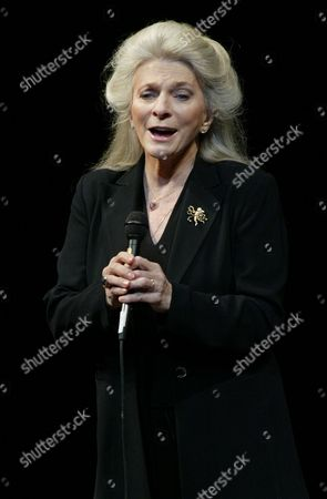 COLLINS Judy Collins sings Amazing Grace at a memorial for actor and monologuist Spalding Gray,held at the Vivian Beaumont Theater in New York's Lincoln Center
