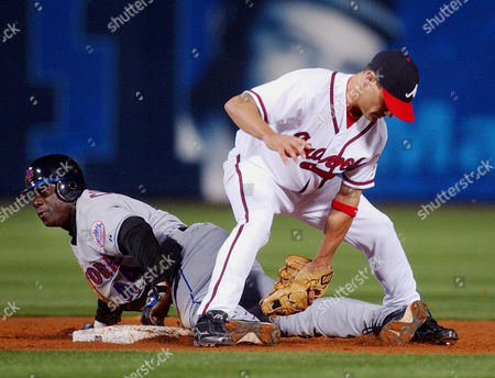 CAMERON GILES New York Mets' Mike Cameron steals second base as Atlanta Braves' second baseman Marcus Giles handles the late throw during the third during in Atlanta