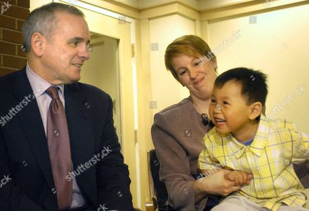 Mark Dayton In this photo made April 15, 2004, U.S. Sen. Mark Dayton, D-Minn.,left, joins Carol Nassif and Luke, a Chinese orphan she and her husband are adopting, at the Children's Home Society in St. Paul, Minn., on . Dayton is running for governor in Minnesota