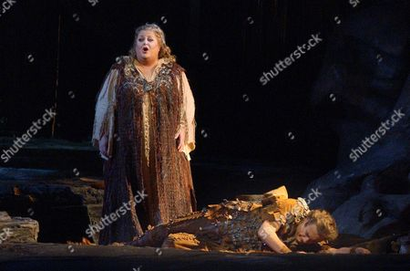 """Deborah Voigt sings the role of Sieglinde over the prone figure of Placido Domingo in the role of Siegmund during the Metropolitan Opera's dress rehearsal of Richard Wagner's five-hour musical marathon, """"Die Walkure,"""" at New York's Lincoln Center"""