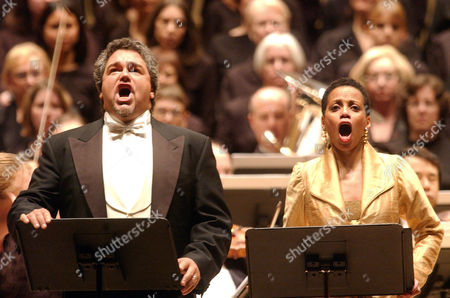 "Tenor Salvatore Licitra, left, and Soprano Harolyn Blackwell perform in a concert performance of Verdi's opera, ""Un Ballo in Maschera,"" with the Collegiate Chorale at Carnegie Hall in New York"