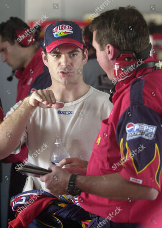 GORDON LOOMIS Driver Jeff Gordon, left, talks with crew chief Robbie Loomis, right, during a break from practice, in preparation for Sunday's NASCAR Ford 400 at Homestead-Miami Speedway in Homestead, Fla