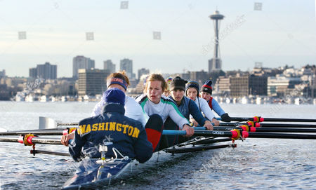 NELSON Members of the U.S. National women's rowing team row a racing shell across Seattle's Lake Union as they begin preparation for the 2004 Summer Olympic Games at a winter training camp . Twenty-eight rowers, including five Olympians and eight world champions, are working out at the eight-day camp, which runs through Jan. 10. The Seattle site was selected because its water and wind conditions are considered similar to the Olympic rowing venue in Schinias, Greece, near Athens. From the rear of the boat are coxswain Mary Whipple, Caryn Davies, Samantha Magee, Anna Mickelson, Ali Cox, Katie Hammes, Kate McKenzie, Kate Johnson and Lianne Nelson