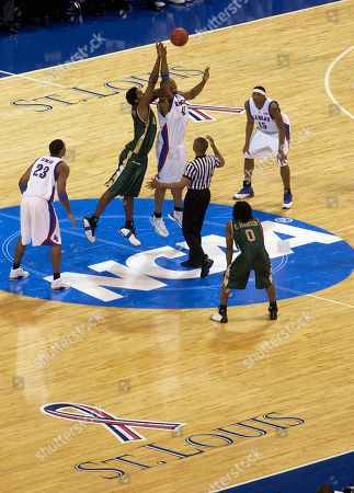 KENNEDY GRAVES UAB's Gabe Kennedy, left center, and Kansas' Jeff Graves go up for the tip to start an NCAA regional semifinal game, in St. Louis