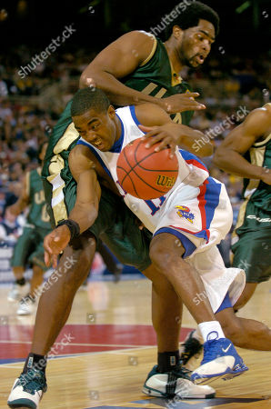 MILES KENNEDY Kansas' Aaron Miles (11) drives past UAB defender Gabe Kennedy during the first half of an NCAA regional semifinal, in St. Louis