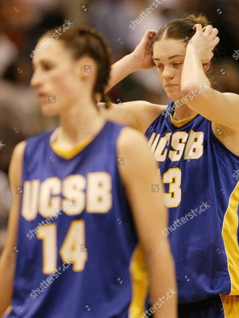 Stock Picture of TAYLOR WILLETT UC Santa Barbara's Lindsay Taylor (13), right, walks off the court with teammate Lisa Willett (14) after their team's 63-55 loss to the University of Connecticut in the women's NCAA East Regional semi-finals in Hartford, Conn