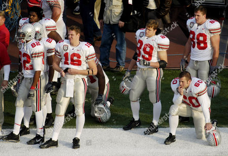 WHITE Ohio State players Roy Hall (82), Maurice Hall (28), Bryce Bishop (78), starting quarterback Craig Krenzel (16), Stan White Jr. (89), Kyle Andrews (60), and Ben Hartsock (88) watch the final moments of their game against Michigan in the fourth quarter on at Michigan Stadium in Ann Arbor, Mich. Michigan won, 35-21. The win gives Michigan the Big Ten championship