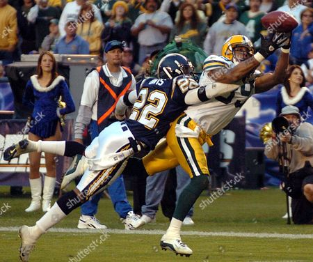 FERGUSON DAVIS Green Bay Packers receiver Robert Ferguson beats San Diego Chargers' Sammy Davis for a 16-yard touchdown reception in the fourth quarter of the Packers' 38-21 victory Sunday, Dec.14, 2003, in San Diego