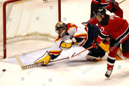 LUONGO RASMUSSEN Florida Panthers goaltender Roberto Luongo, left, makes a save on a shot by New Jersey Devils' Erik Rasmussen during the first period Thursday night, in East Rutherford, N.J