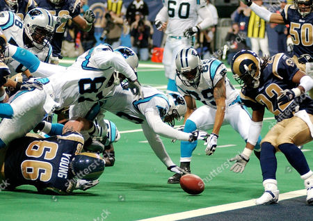 SMITH Members of the St. Louis Rams' Brian Young (66) and Travis Fisher (22) and Carolina Panthers' Muhsin Muhammad (87), Ricky Proehl (center) and Steve Smith (89) dive for the loose football during a fumble following a shuttle-pass during the first half of their NFC playoff game in St. Louis, . The loose ball was recovered by Muhammad for a touchdown. The play was reviewed by the officials and the loose ball and recovery by the Panthers was ruled a touchdown