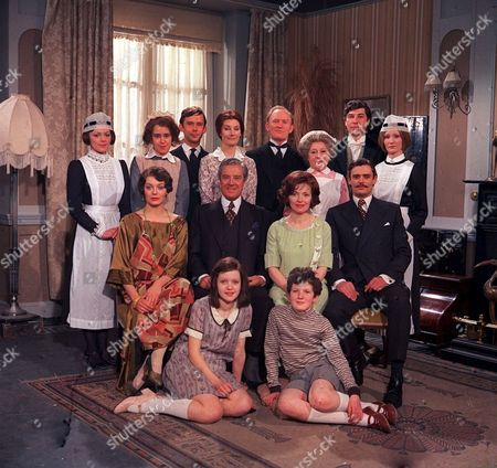 'Upstairs Downstairs' - 1970's L-R Back: Jacqueline Tong, Jenny Tomasin, Christopher Beeney, Jean Marsh, Gordon Jackson, Angela Baddeley, Gareth Hunt and Karen Dotrice. Middle: Lesley-Anne Down, David Langton, Hannah Gordon and Simon Williams. Front: Meg Wyn-Owen.