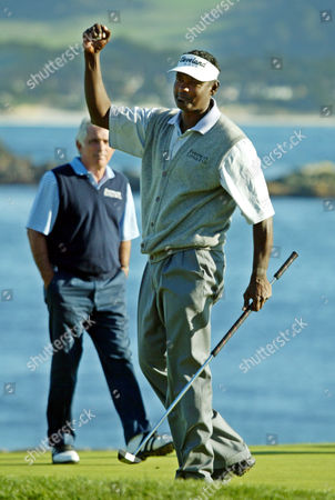 Stock Photo of SINGH FORSTMANN Vijay Singh, foreground, reacts on the 18th green of the Pebble Beach Golf Links after winning the AT&T Pebble Beach National Pro-Am in Pebble Beach, Calif., . Singh shot a three-under-par 69 to finish at total 16-under-par. At left is amateur Teddy Forstmann