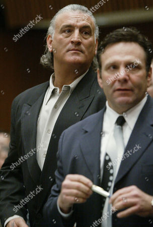 BUTTAFUOCO Joey Buttafuoco, left, who made national headlines a decade ago when his 17-year-old girlfriend shot his wife in the face, listens as his lawyer Jonathan Kissel addresses the court during hearing, in Los Angeles. Buttafuoco, 47, entered not guilty pleas to three charges of insurance fraud and one count of grand theft involving his San Fernando Valley body shop. He was ordered back to court on Feb. 25 for a judge to determine whether there is enough evidence to hold a trial