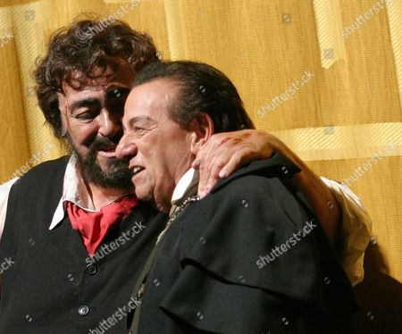 """Luciano Pavarotti, left, hugs Charles Anthony during the curtain call of Puccini's """"Tosca"""" at the Metropolitan Opera in New York . The evening's performance celebrated the 50th anniversary of Anthony's Metropolitan Opera debut"""