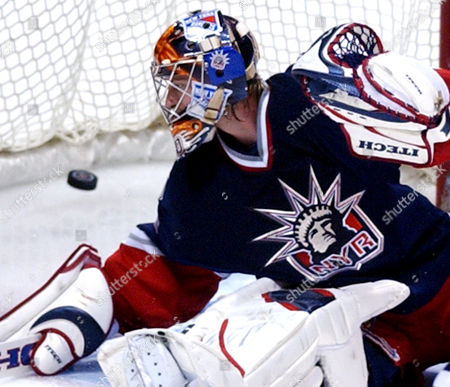 VALIQUETTE New York Rangers goaltender Stephen Valiquette cannot stop the puck as New Jersey Devils' Erik Rasmussen scores during the third period Tuesday night, in East Rutherford, N.J. The Devils beat the Rangers 5-0