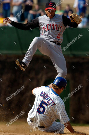 OLMEDO BARRETT Cincinnati Reds' Ray Olmedo (4) leaps over Chicago Cubs' Michael Barrett (5) after beating Barrett to second for a force out to end the game in the bottom of the ninth, in Chicago. The Reds won the game, 3-2