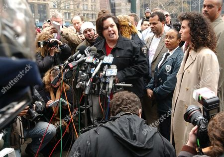 Stock Picture of Rosie O'Donnell, center, talks to reporters after leaving state Supreme Court, in New York. A Manhattan judge ruled there is no winner in the court battle between O'Donnell and Gruner + Jahr the publisher of her defunct magazine. At right is Cindi Berger, O'Donnell's publicist