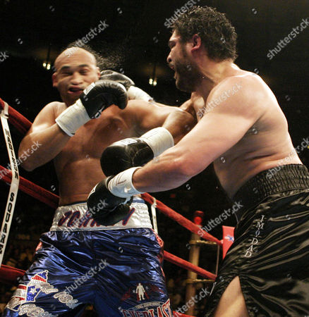 John Ruiz, right, of Methuen, Mass., hits Fres Oquendo, of Puerto Rico, in the eleventh round of a WBA World Heavyweight Championship bout at Madison Square Garden in New York, . Ruiz won with an eleventh round technical knockout when referee Wayne Kelly stopped the fight