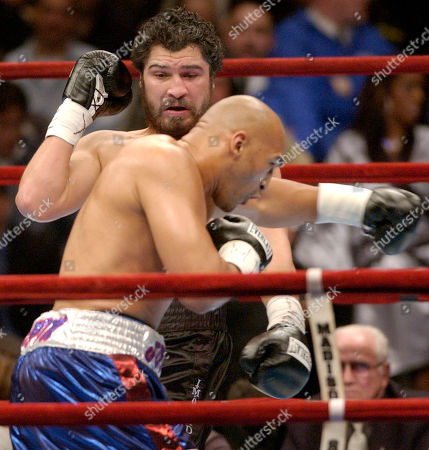 John Ruiz, left, of Methuen, Mass., and Fres Oquendo, of Puerto Rico, trade punches in the first round of a WBA World Heavyweight Championship bout at Madison Square Garden in New York
