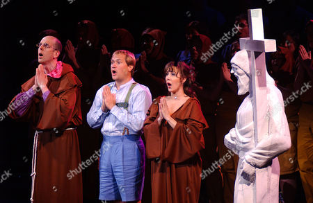 """Jeff Blumenkrantz, left, as Maximillian, Paul Groves, center, as Candide; and Janine LaManna as Paquette sing during the dress rehearsal of a concert version of the Leonard Bernstein musical """"Candide"""" at Lincoln Center in New York on"""