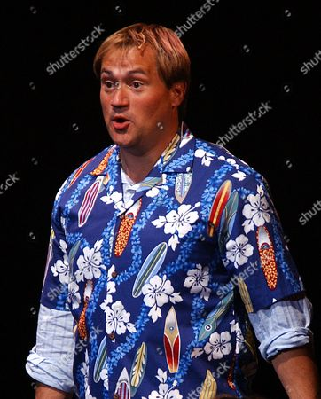 """Paul Groves in the title role, sings during the dress rehearsal of the New York Philharmonic's presentation of the concert version of """"Candide"""" at the Lincoln Center in New York on . The show open Wednesday night May 5 and has a limited run until May 8"""