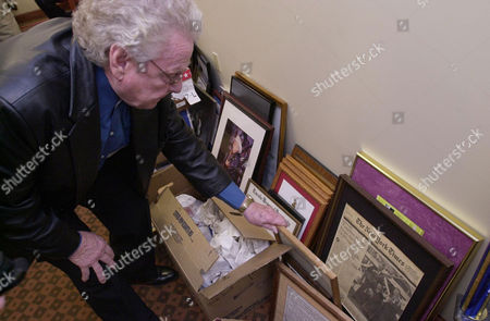 STANLEY Ralph Stanley looks through memorabillia for the Ralph Stanley Museum and the Traditional Mountain Music Center Jan.15, 2004, in the Jetty Baker Center in Clintwood, Va