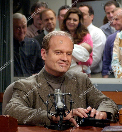 "GRAMMER Kelsey Grammer as Dr. Frasier Crane pauses a moment after the director calls ""cut"" after Crane read his final broadcast message in the show's radio station set, while fellow cast members and show staff watch through the window at rear during the filming of the final episode of ""Frasier"" on a set at Paramount Studios in Los Angeles . Hugs, champagne toasts and snippets of poetry marked the filming of the last episode of NBC's long-running sitcom ""Frasier."" The series, which started as a spinoff of ""Cheers,"" will end its 11-season run with an hour long finale titled Good Night Seattle"" on May 13"