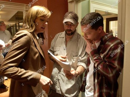 """MALINA JANNEY SCHIFF Actors Josh Malina, right, who portrays White House aide Will Bailey on NBC's """"The West Wing,"""" goes over a scene with cast members Allison Janney, left, as press secretary C.J. Cregg, and Richard Schiff, who plays Toby Ziegler and is directing this episode, during filming in Burbank, Calif"""