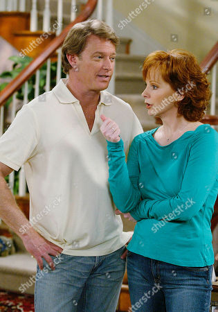 """MCENTIRE RICH Country superstar Reba McEntire, right, and actor Christopher Rich appear on the set of The WB's """"Reba,"""" at the 20th Century Fox studios in Los Angeles, March, 16, 2004. Now in its third season the show is a solid hit, particularly with women and female teens, that takes aim at the all-American family with a spirited Southern look at suburban dysfunction"""