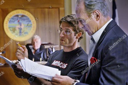 "DYKE Director Jonathan LaPaglia, center, works with actors Craig T. Nelson, right, and Jerry Van Dyke, background, on the set of the CBS drama ""The District,"" in Los Angeles"