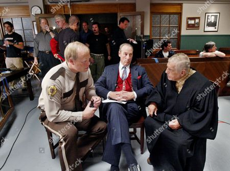 "DYKE Actors Bill Fagerbakke, left, Craig T. Nelson, center, and Jerry Van Dyke, relax during a break on the set of the CBS drama ""The District,"" in Los Angeles, Feb. 23, 2004. The actors, who played football coach Hayden Fox and his goofball assistants, Luther Van Dam and ""Dauber"" Dybinski, for nine seasons on the sitcom ""Coach,"" are staging a reunion of sorts in ""The District"" airing at 10 p.m. EST"