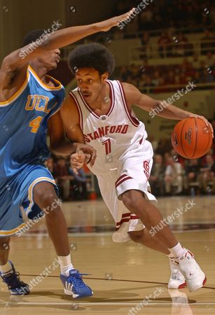 CHILDRESS ARIZA Stanford forward Josh Childress drives to the basket in front of UCLA forward Trevor Ariza in the first half, in Stanford, Calif