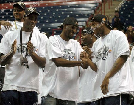 OKAFOR GORDON BROWN Connecticut's Ben Gordon, center, and Taliek Brown, right, laugh together as Emeka Okafor, left, looks on during a homecoming rally for the UConn men's basketball team at Storrs, Conn., . The Connecticut team won the NCAA Division I Men's Basketball Championship in Monday, April 5, in San Antonio, when they beat Georgia Tech 82-73
