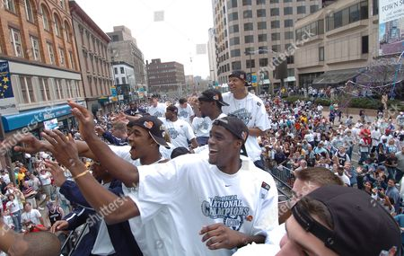 OKAFOR Connecticut junior Emeka Okafor waves to the crowd with teammates as they pass outside the Hartford Civic Center during a joint parade for the men's and women's college basketall national champions in Hartford, Conn