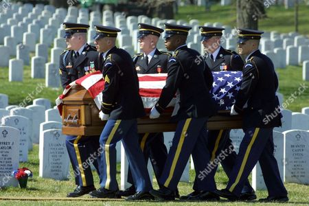 An Army honor guard carries the casket of Spc. Jason Christopher Ford of Bowie, Md., during funeral services at Arlington National Cemetery in Arlington, Va., . Ford was killed while on his patrol in Tikrit, when a roadside bomb exploded next to his vehicle on March 13