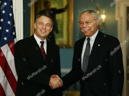 POWELL GOFF Secretary of State Colin Powell, right, greets New Zealand Minister of Foreign Affairs and Trade Philip Goff, before the start of their meeting at the State Department, in Washington