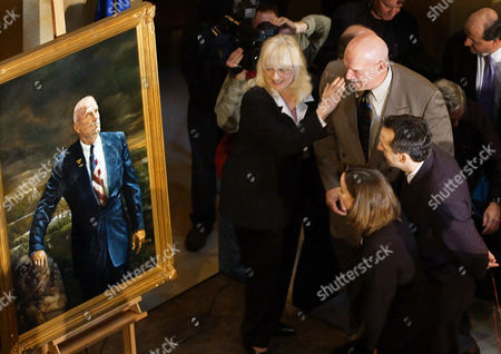 VENTURA PAWLENTY LARSON Former Minnesota governor Jesse Ventura, upper right,stands with his wife's mother, Sharon Larson, left, as Ventura and present Gov. Tim Pawlenty, center-right, and his wife Mary Pawlenty, lower right, get a closer look at Ventura's official gubernatorial portrait after in was unveiled in the state Capitol Rotunda, in St. Paul, Minn