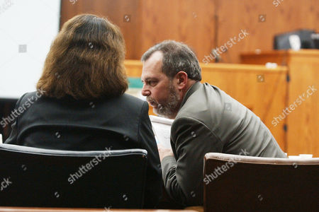 CROWE LEMBER Hunderton County Assistant Procecuter Marcia Crowe, left, listens to First Assistant Prosecutor Steven Lember review charges in the Jayson Williams' manslaughter trial at the Somerset County Courthouse in Somerville, N.J., . Williams is on trial for the shotgun shooting and killing of limousine driver Costas Christofi at Williams' estate in Alexandria Township, N.J., Feb. 14, 2002