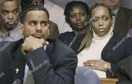 TANYA JAYSON WILLIAMS Tanya Williams, right, sits behind her husband, Jayson Williams, during his manslaughter trial at the Somerset County Courthouse in Somerville, N.J., . Tanya is due to give birth to their second child in early April, which could further delay the trial, delayed once already by the death of a defense attorney's mother. Tanya's father, Norwood Young, is on left