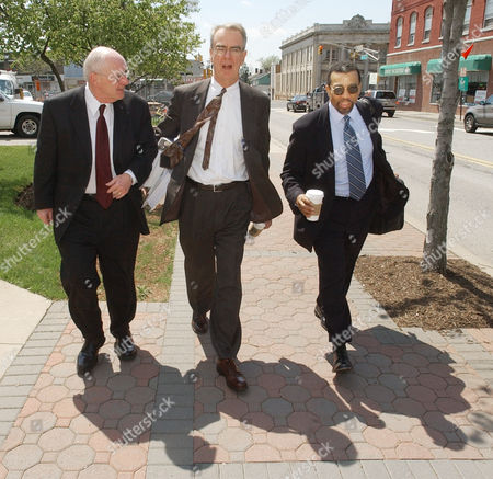 KELLY HAYDEN MARTIN Jayson Williams' attorneys Michael Kelly, left, Joseph A. Hayden Jr., middle, and Billy Martin return to the Somerset County Courthouse in Somerville, N.J., during jury deliberations in Williams' manslaughter trial, . Williams is on trial for the shotgun shooting and death of hired driver Costas Christofi at Williams' estate in Alexandria Township, N.J., Feb. 14, 2002