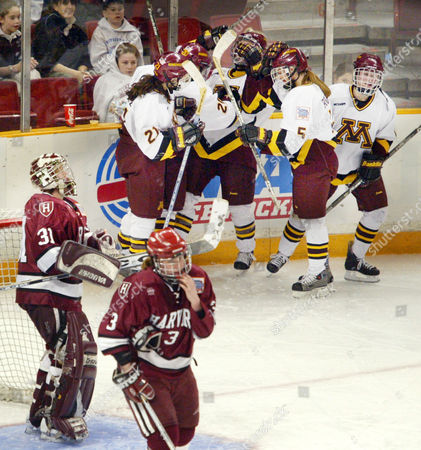 BOE BANFIELD The Minnesota women's hockey team celebrates a fifth goal during the third period as Harvard goalie Alie Boe (31) and Ashley Banfield (3) look on during the NCAA Women's Championship game in Providence, R.I. Minnesota won 6-2