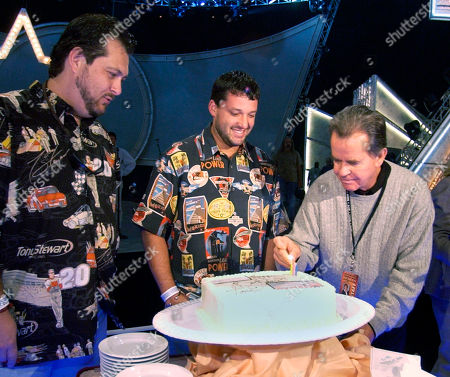 CLARK WILLIAMS STEWART Producer Dick Clark, right, lights a candle on a birthday cake for NASCAR driver Tony Stewart, center as Dana Williams from Diamond Rio looks, at the Mandalay Bay Events Center in Las Vegas. Diamond Rio will perform during the Academy of Country Music Awards show Wednesday at the hotel. Stewart, who will also appear on the show, celebrates his 32nd birthday today